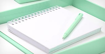 mint pen, white spiral notepad, and mint tray